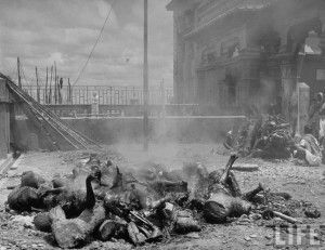 Corpses lying among pieces of wood in preparation for cremation after bloody rioting between Hindus and Muslims Calcutta (Kolkata) 1946
